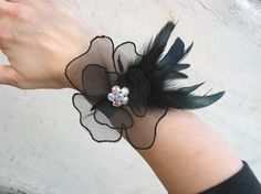 Feather Wedding Corsages ... love the idea but not the feather...thinking shamrock shape in Ivory with green center...YEAH!