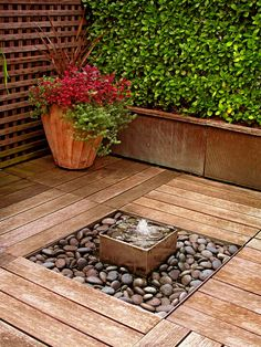 Ok, so if we prep before we build the deck we could totally do this!  Leave an open space on part of the existing porch and put a container in it for the water feature!!!