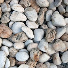 """Multi-colored 3/8"""" round, Delaware river stone. This is the smallest of the three Delaware River Stone products that we offer. Hues of grey, brown, blue, and tan used in walkways, gardens and around pools. Very easy to walk on.   Sold by the cubic yard, 1 yard min.   Use our  to figure out how much you need. (Always round up when you place your order.)"""