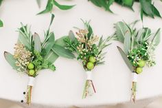 boutonnieres with berries - photo by Kelly Sweet Photography http://ruffledblog.com/botanical-garden-wedding-with-glass-ceilings