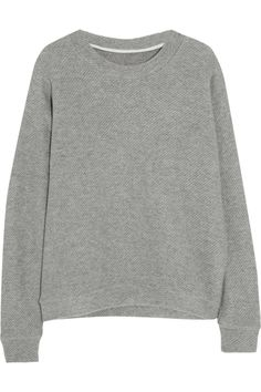 Wrap up in style for the cooler weather with our definitive guide to the season's coolest cover-ups. The Elder Statesman Herring cashmere sweater