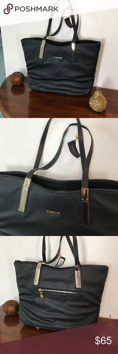 🎉 1 HOUR SALE!! ❤️ NWT Bebe black tote 👜 NWT Bebe black tote with gold accents! Comes with cross body strap. Comment with any questions bebe Bags