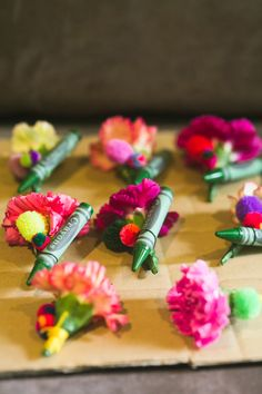 boutonniere with crayon, poms, and flowers, photo by Lara Hotz http://ruffledblog.com/australian-polo-club-wedding #boutonnieres #grooms