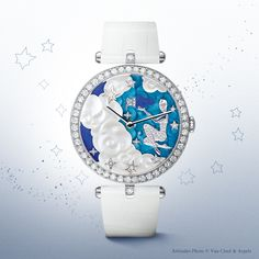 Van Cleef & Arpels Lady Arpels Zodiac Aquarius timepiece, Extraordinary Dials™ collection #PoeticAstronomy #SIHH2014 -White gold case, 38mm diameter, bezel set with round diamonds, crown set with a round diamond -Dial: white gold, diamonds, translucent enamel, mother-of-pearl, lapis lazuli -Manual-winding mechanical movement -White alligator bracelet, pin buckle set with round diamonds