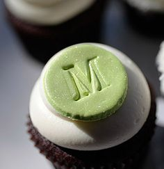 @Jean Hansen - we could also do all white monogram cupcakes like this one, I did a similar one for Alec's baptism.  Frosting can either be smooth swirl or 1M swirly.  :)