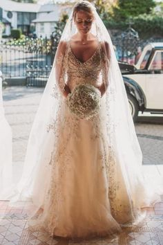 Beautifully embellished wedding gown. (I like the understated bouquet, lets the gown take center stage).