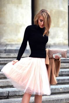 Romantic look 2015 - pink tulle skirt and classical black blouse in combination with beige handbag and coat.
