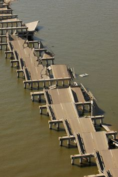 Photograph by John Fleck via Wiki ~ The Bay Bridge during Hurricane Katrina.     Hurricane Katrina The Bay bridge on US Highway 90, damaged by Hurricane Katrina On August 29, 2005 at 10:00 a.m. CDT, Hurricane Katrina made its final landfall near Bay St. Louis, at the mouth of the Pearl River, with a 28-foot (8.5m) storm surge. Hurricane Katrina came ashore during the high tide of 9:15AM, +2.3 feet more,[4] causing  a storm tide over 30 feet  (9.1m) deep. USGS Topographical maps show