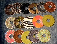 Decorating washers using craft paper and mod podge.