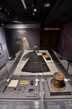 """Cases including the contents of Abraham Lincoln's pockets, Top Hat and Greatcoat from the night of the assassination. Items now on display as part of """"Silent Witnesses"""" at the Ford's Theatre Center for Education and Leadership. Photo by Gary Erskine."""