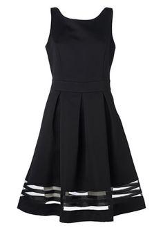 Seppälä: Hihaton mekko, takana V-aukko. Hameosa laskostettu. Helman alaosassa kaistale läpinäkyvää kangasta.