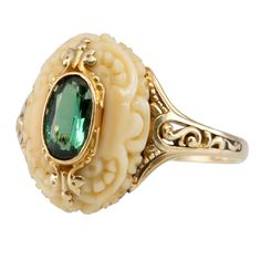 ca. 1900 Victorian Ring with a carved bone center having a single Tourmaline