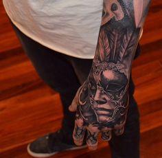 Portrait hand tattoo
