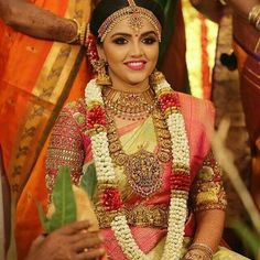 South Indian bride in nakshi work long chain and choker, temple jewellery South Indian Bridal Jewellery, Indian Bridal Fashion, Indian Wedding Jewelry, Bridal Jewelry, Bridal Accessories, Flower Garland Wedding, Wedding Garlands, Wedding Decorations, Bridal Jewellery Inspiration