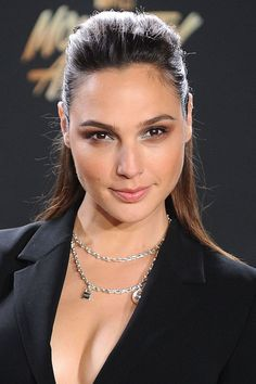 "Slicked back and stunning, she also sometimes sports [link url=""http://www.glamourmagazine.co.uk/gallery/celebrity-straight-hair-tips""]sleek straight hair[/link] like a pro."