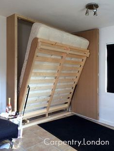 Fold down space saving wall bed. Why sleep on an uncomfortable sofa-bed just because you have space for a normal bed? This stow away bed was designed and built by Carpentry.London, it features a full size king size mattress and is made for everyday u Cama Murphy, Fold Down Beds, Diy Bett, Modern Murphy Beds, Hidden Bed, Murphy Bed Plans, Full Size Murphy Bed, Large Beds, Kids Bunk Beds