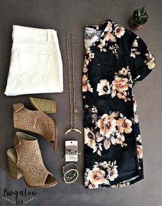 Soft french terry floral-printed top in Charcoal. Short-sleeves with v-neck and pleated back detail. Pullover style with single front pocket. If in-between sizes, we recommend ordering the smaller of