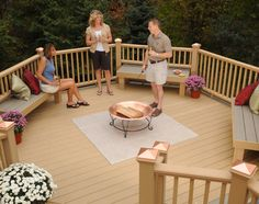 Latitudes Intrepid composite decking and railing with deck stones under fire pit.