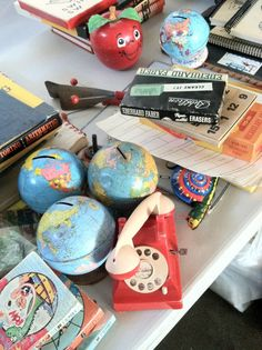 Flea Market Style... I have bought and resold those globe banks. couldn't keep them for 24 hours. I could use some stuff for scrapbooking/crafts.