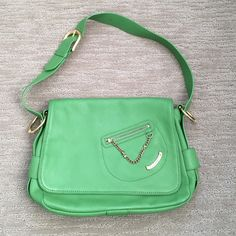 "Juicy Couture Bright Green Leather Bag with Gold Great condition like new used a few times . Cool Juicy Couture medium size bright green leather shoulder bag with gold hardware and logo lined interior. Adjustable shoulder strap. Comes with pink logo dust bag. Measures 11"" wide x 9"" tall x 4"" deep. Juicy Couture Bags Shoulder Bags"