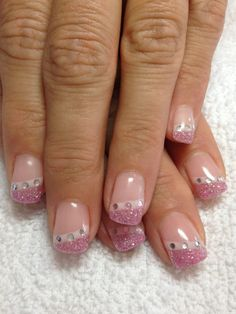 Gel nails. Pink glitter tips with rhinestones.