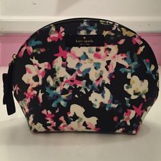 "Kate Spade Cosmetic Bag Kate Spade 'Keri' Cosmetic bag in a cyber, mulifloral pattern! I love this, but I have so many cosmetic bags already that I don't really need it. I've only stored makeup in this bag, and I've never traveled with it. Dimensions approx.: 7"" l x 5.4"" h x 1.8"" d. kate spade Bags Cosmetic Bags & Cases"