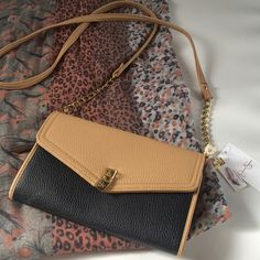 Jessica Simpson Michelle Crossbody NWT Jessica Simpson Michelle clutch sized Crossbody bag. Leather and chain straps, many interior pockets and beautiful patterned inside. Very small scuff as shown in 4th picture. Jessica Simpson Bags Crossbody Bags