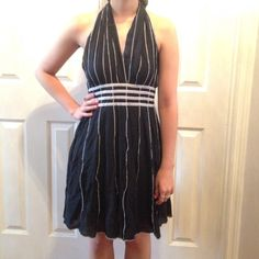 Black Dress Black plunging V-neck Dress w/ white stitch details. Ties at neck & has a band of stripes around waist. Dress is lined, chest area is not. Would make a cute cover up. New. Katie Dresses Midi