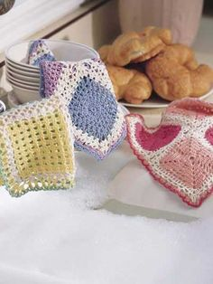 Dainty Dishcloths  Colorful pearl cotton make these dishcloths a delight to the eyes as well as handy dish scrubbies!  Designed by Lucille LaFlamme  free pdf from free-crochet.com