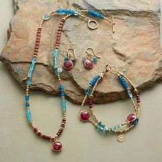 RUBY BLUES COLLECTION, SET OF 3 - Ruby rounds in golden rims are spotlights amid a mix of apatites. 14kt gold filled beads and paillettes lend their glow to this handmade ruby and apatite jewelry set.