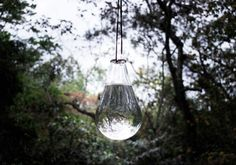 influenced by traditional mexican methods for scaring flies away at urban food markets with plastic bags full of liquid hanging from the ceiling. Could do the same with an old light globe I think.