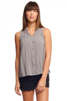 Effortlessly elegant! This refined button down top is ideal to pair with just about anything!
