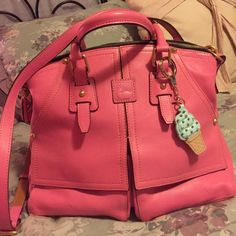 Dooney & Bourke Clayton ❤️Sale❤️ Dooney and bourke Clayton Handbag in baby pink so cute and so spacious. Preowned but still pretty great condition. Corners have very lightly worn. The bottom back has 2  SUPER LIGHT marks front pockets have a light tiny dent like due to storage. .comes with Crossbody strap and dustbag Dooney & Bourke Bags