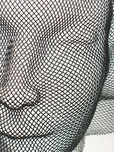 black wire mesh woman's face wall sculpture by HumanScaleStudio, $95.00