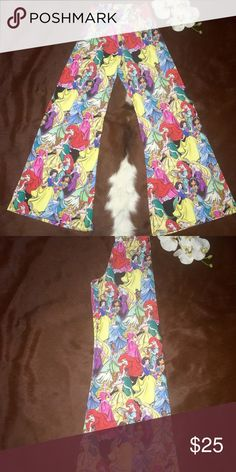 """DISNEY PRINCESS PALAZZO IN GREAT CONDITION USED ONCE AT MAGIC KINDOM  ONLY available for purchase at Disney theme parks only !! Adorable, lightweight, with every princess on them.  SIZE XS  92% polyester 8% spandex Inseam 31"""" Disney Pants"""