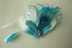 Bridal Feather Fascinator Ivory & Teal  by PowderBlueBijoux, $75.00...little too expensive but LOVE the idea
