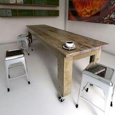 Reclaimed wooden table on castors