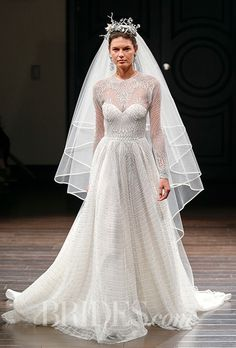 "Brides: Naeem Khan - Spring 2016. ""Washington"" long sleeve tulle A-line wedding dress with an illusion neckline and metallic wave beaded bodice, Naeem Khan"