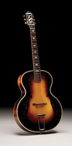 Epiphone De Luxe Masterbilt  Introduced in June 1931, the Deluxe was designed to compete with the Gibson L-5. Both guitars carried a  $275 price tag and the De Luxe Masterbilt remained Epiphone's flagship model from 1931 until late 1935, when the Emperor was introduced.     Measuring 16 3/8 inches across