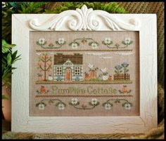 """This cross stitch pattern is titled """"Pumpkin Cottage"""" and comes from Country Cottage Needleworks. The model is stitched with DMC, Crescent ..."""