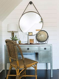 """""""The room just called for a little spot like that when you enter the space,"""" laughs Matthew, who tucked away a painted metal desk that was his husband's and a beloved BDDW mirror just off the doorway. """"We try not to do any serious work in here. Maybe writing a letter or a thank-you card."""""""
