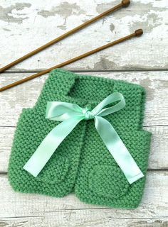 Check out this item in my Etsy shop https://www.etsy.com/uk/listing/225938931/hand-knitted-baby-girl-vest-gilet-jade
