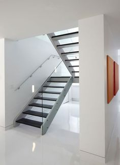 Modern Staircase but would use a simpler hand rail in black maybe