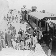 """""""Summit Mt. Washington, from the Clouds,"""" from a stereograph by B.W. Kilburn, c. 1890. After the arrival of a train on a summer day, the platform next to the Summit House was often crowded with tourists. During the 1880s and the 1890s a part-Newfoundland dog named Medford, sometimes accompanied by a canine friend, welcomed visitors to the summit and was often included in photographs taken. Mt Washington Cog Railway - Bretton Woods, NH"""