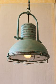 "This lighting has the perfect combination of a married industrial and french cottage style. The antique turquoise paint feminizes the masculine metal and caging. This is a must have kitchen bar light or bathroom pendent!13""d x 19""t"