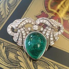 Emerald cabochon brooch