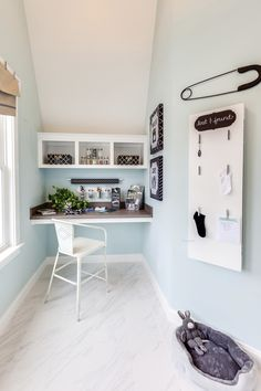 crafting nook in laundry room of  2015 Coastal Virginia Magazine Idea House. wall paint color: SW 6477 Tidewater