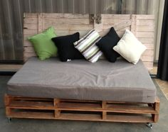 Pallet day bed with old door