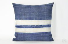 One of a kind bohemian decorative pillow cover made with vintage Hmong textiles, hand-printed in batik technique and indigo dyed.  [ Front ] Vintage handwoven Hmong hemp fabric hand-printed with beautiful batik patterns and indigo dyed. Formerly a Hmong womans skirt.  [ Reverse ] Plain cream color hemp-cotton fabric.  [ Approx. Measurement ] 20 x 20 (50 cm x 50 cm)  [ Details ] Invisible zipper at the bottom.  Fully finished seams (zig-zagged or overlocked).  Fully lined interior.  [ Care ]…