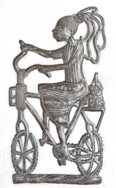Fair Trade 9 x 16 Fair Trade 9 x 16 Riding Bike Haitian Metal Art from Recycled Oil Drums metal art haiti Girl in a Bicycle its cactus